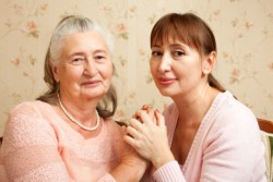 woman holding a hands of an old woman